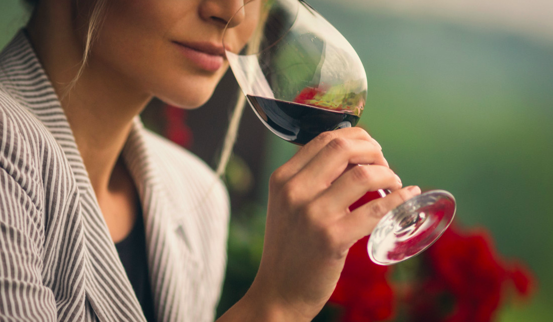 Woman sipping alcohol